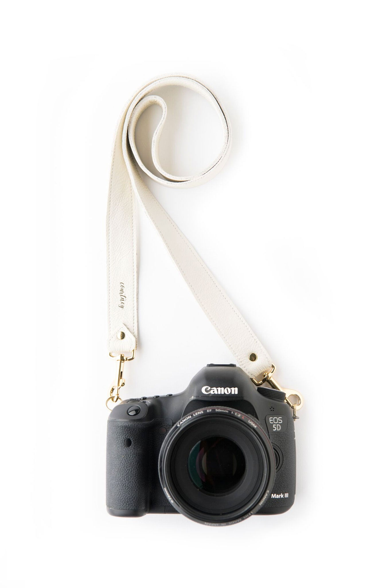 FOTO | The Designer in Ivory - an ivory white genuine pebbled leather camera strap that can be personalized with a monogram or business logo, making this leather camera strap the perfect personalized gift.