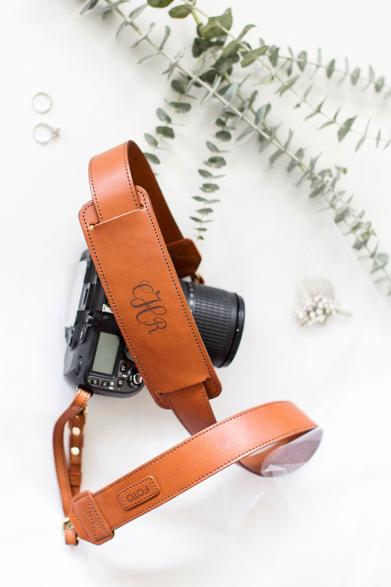 FOTO | The James Fotostrap for newlyweds - a cognac brown genuine all-leather camera strap that can be personalized with a monogram or personal graphic, making this leather camera strap the perfect personalized gift.
