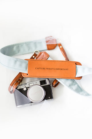 FOTO | The Sky Fotostrap for Newlyweds - a light blue canvas and genuine leather camera strap that can be personalized with a monogram or personal graphic, making it the perfect personalized gift!