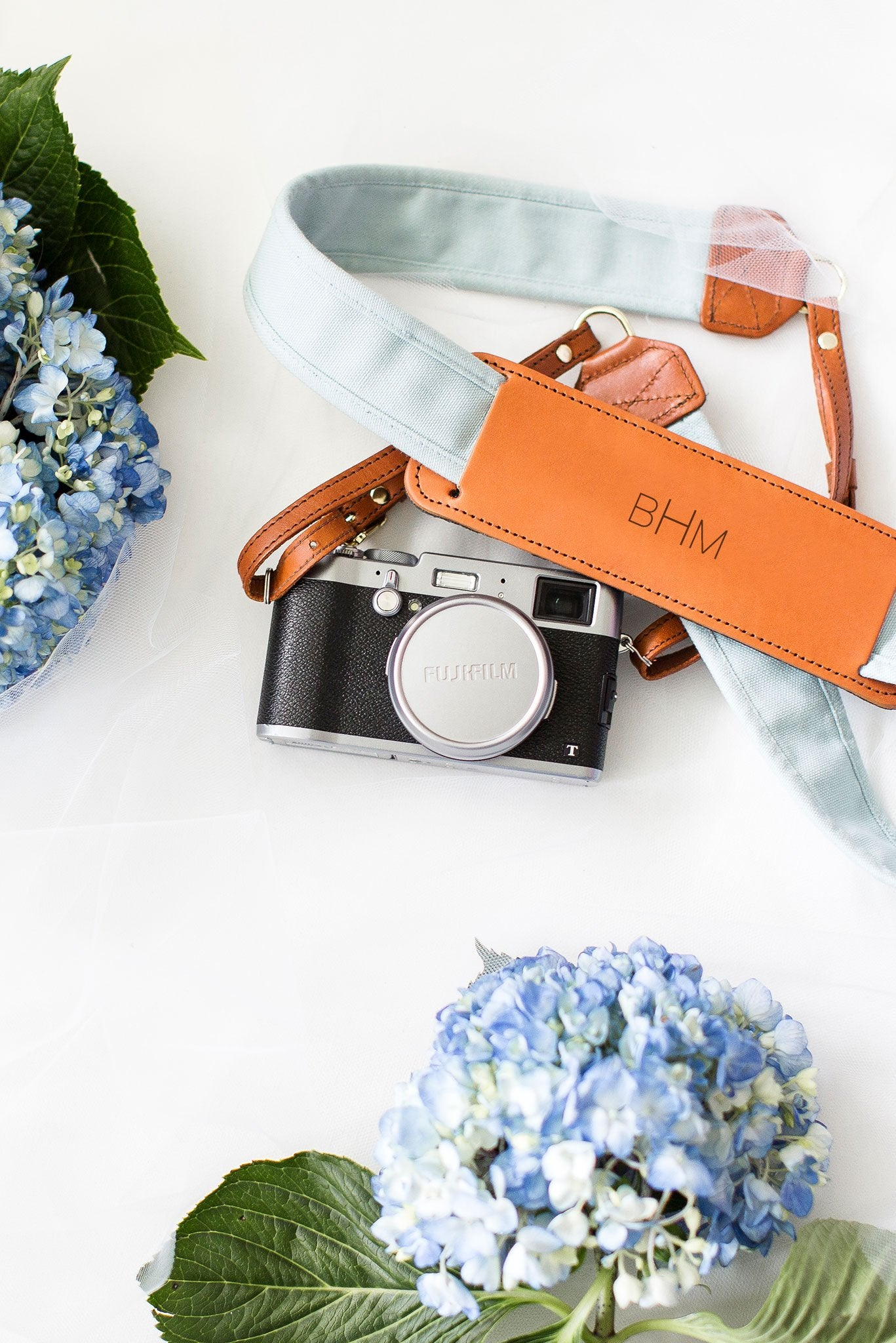 FOTO | The Sky Fotostrap for Her - a light blue canvas and genuine leather camera strap that can be personalized with a monogram or personal graphic, making it the perfect personalized gift!