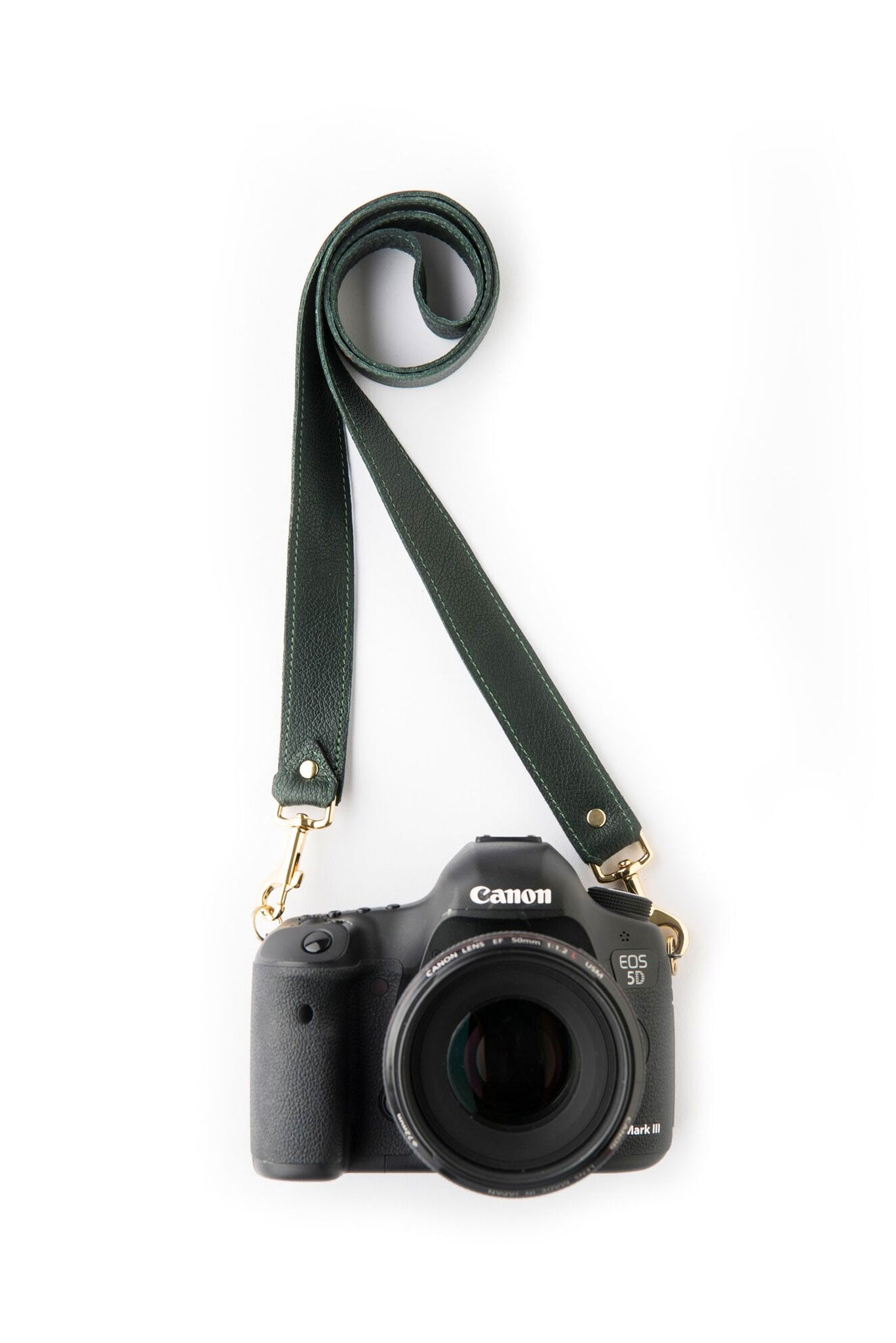 FOTO | The Designer in Pine - a pine green genuine pebbled leather camera strap that can be personalized with a monogram or business logo, making this leather camera strap the perfect personalized gift.