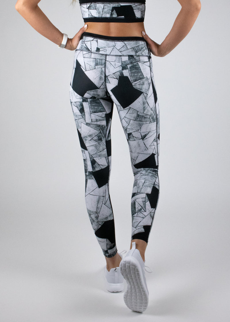 Full length Hiiu leggings in the matt black and white blkgrain print with mid-rise waist from Susimust SS19 collection blkgrain - back view of the leggings