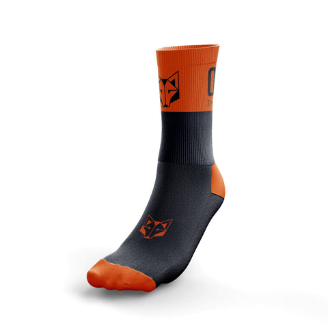 Half-height socks from the Otso brand in orange and black. Rear photo