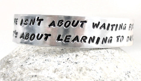 Life Is About... Learning to Dance in the Rain - Aluminum Bracelet