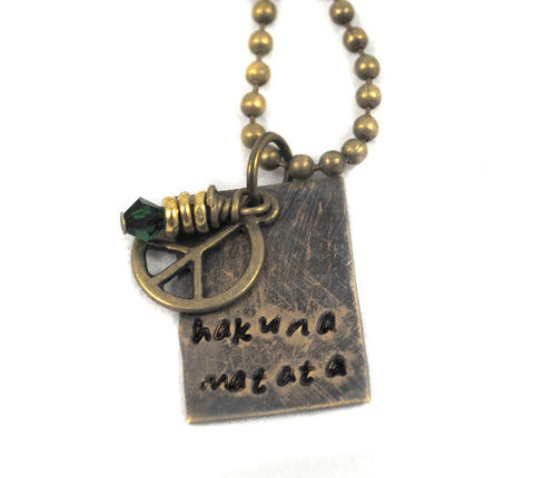 Hakuna Matata - Antiqued Brass Rectangle Necklace with Green Crystal and Peace sign - Lion King Inspired