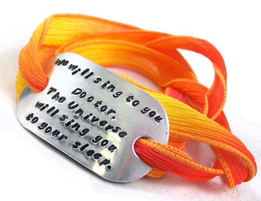We will sing to you, Doctor… - Aluminum ID Bracelet w/Silk Wrap