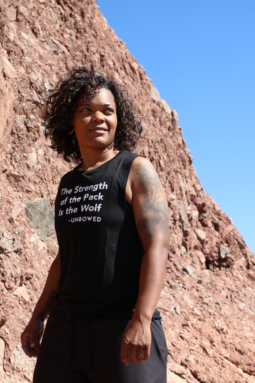 THE STRENGTH OF THE PACK IS THE WOLF WOMEN'S MUSCLE TANK - UNBOWED