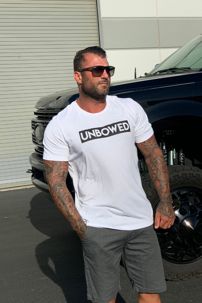 THE STRENGTH OF THE PACK IS THE WOLF MEN'S TRI-BLEND TEE (AVAILABLE IN 5 COLORS) - UNBOWED