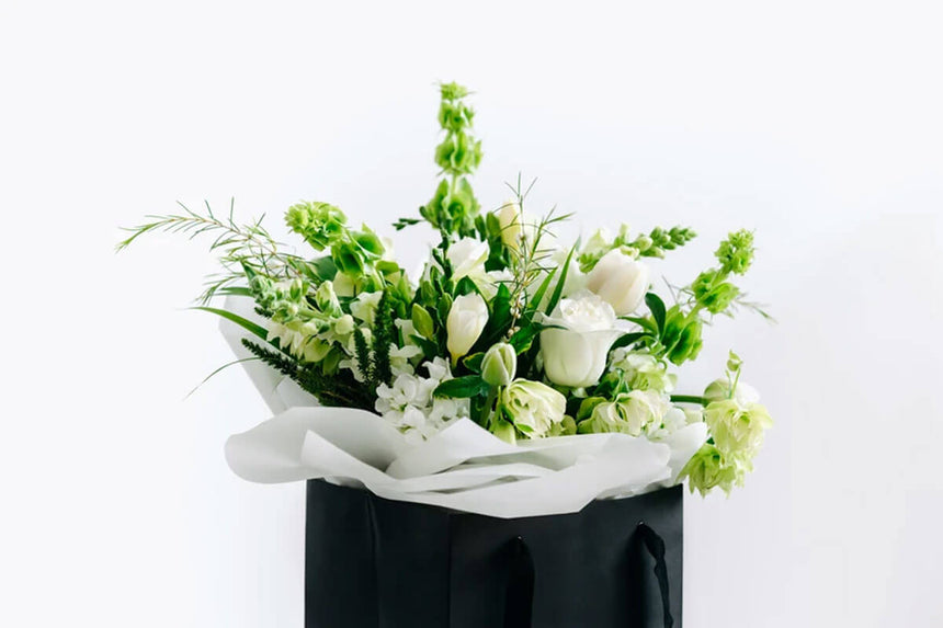 A timeless bouquet of fresh white blooms and natural greens