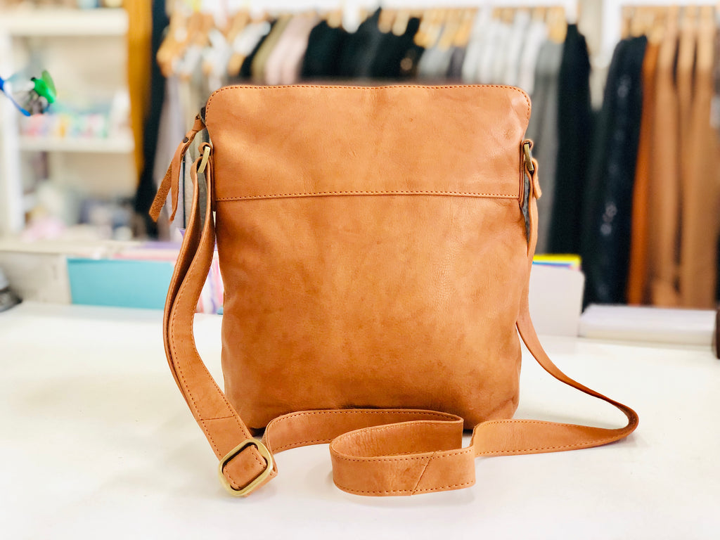 Cowhide leather messenger bag in natural tan leather.