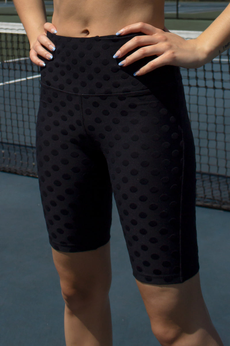 black polka dot biker shorts from our activewear collection