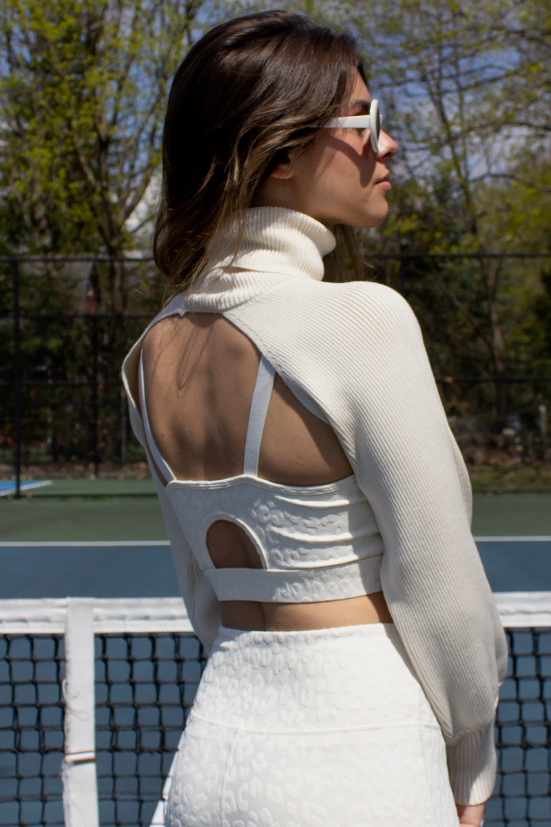 open back rib knit turtleneck shrug in cream