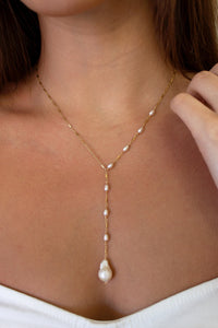 dainty pearl drop necklace with a baroque pearl pendant