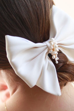 Close up of the Margot Pearl and Silk Bow Barrette