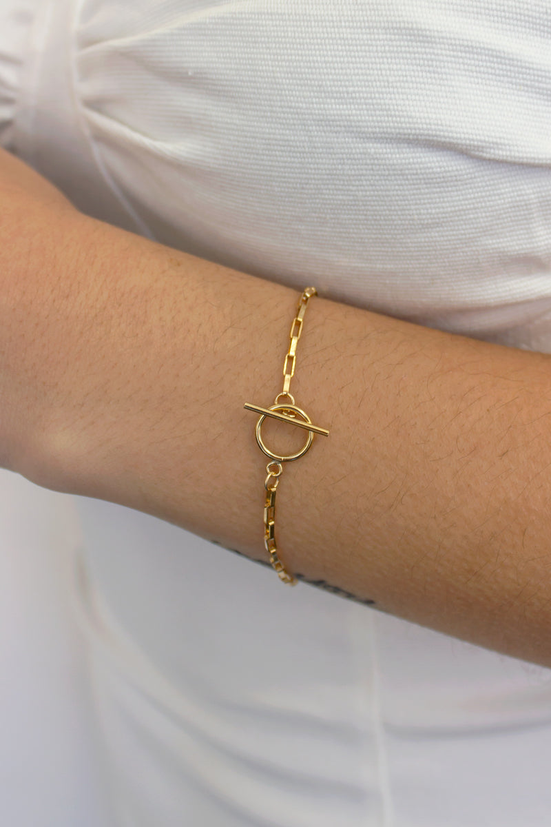 layering bracelet with gold filled chain links and toggle