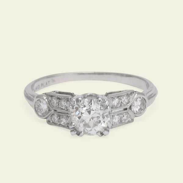 Platinum Engagment Ring with Twinned Shoulders and Pear-Shaped Accents
