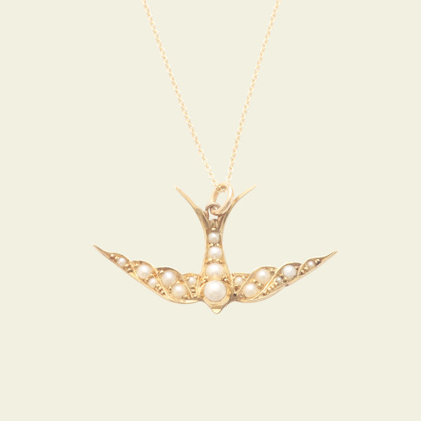 Pearl-Studded Gold Swallow Necklace