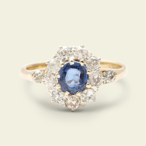 Edwardian Oval Sapphire and Old Mine Cut Diamond Cluster Ring