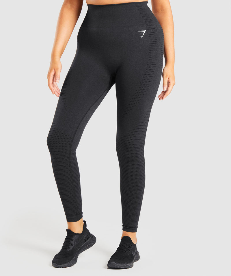 Image A shows the front of a model wearing Vital Seamless Leggings in black.