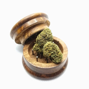 H2 CBD Hemp in a wooden grinder