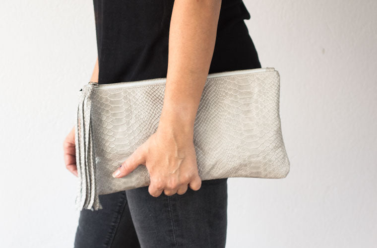 The Leto clutch in grey snakeskin