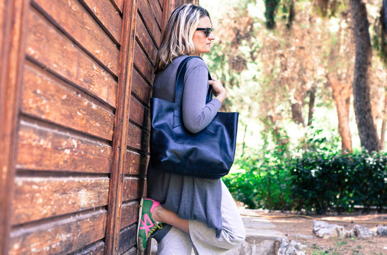 The Calisto tote bag in black leather over shoulder by milloo