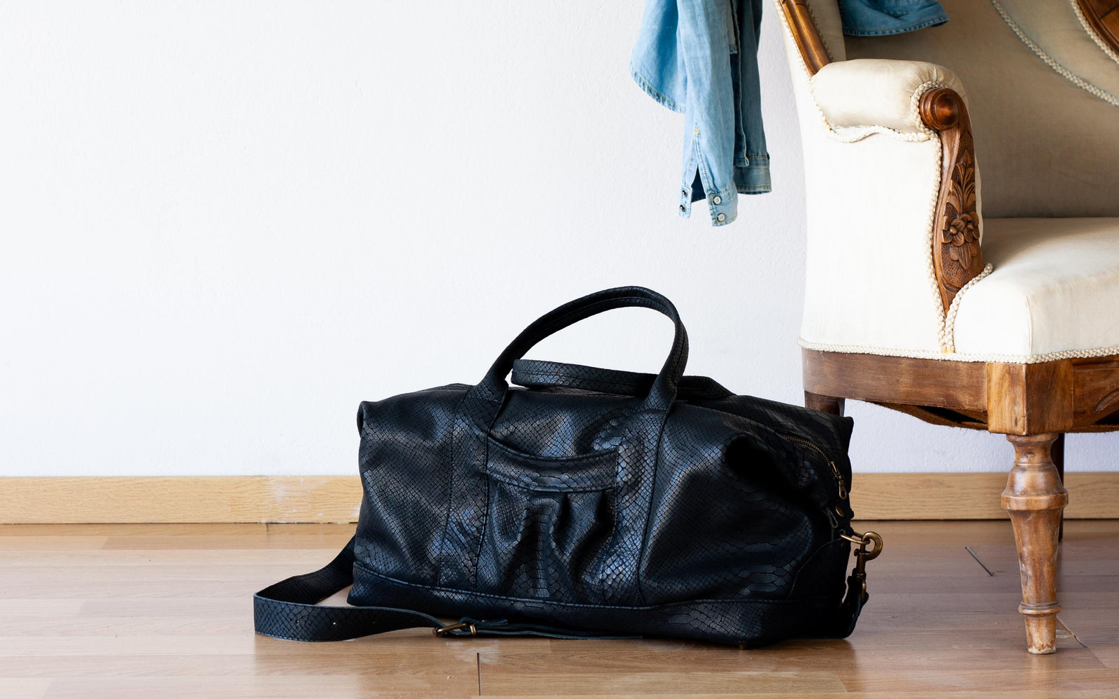 The Nephele duffel bag in black snakeskin leather by milloo