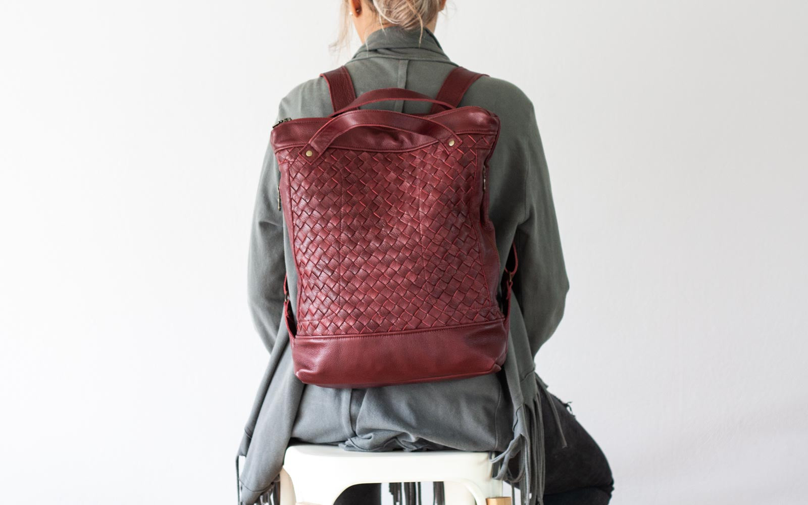 The Minos backpack in handwoven burgundy leather by milloo