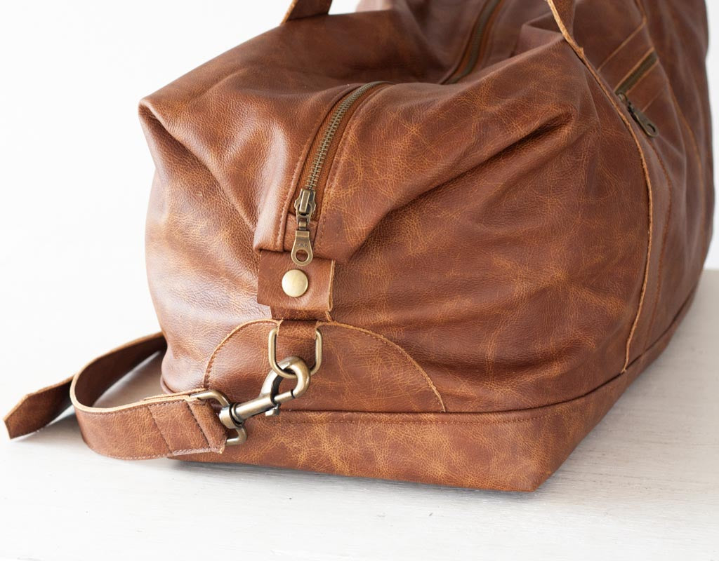 The Nephele duffel bag in brown leather by milloo in Athens Greece