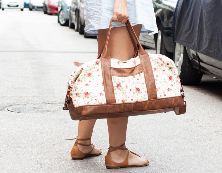 The Nephele duffel bag made with floral canvas and brown leather by milloo in Athens Greece