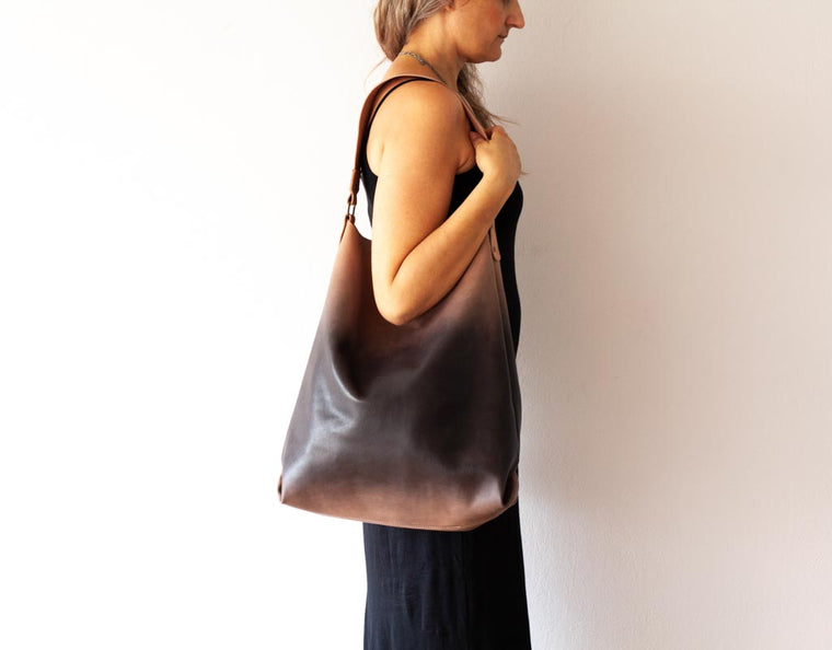 The Amara tote bag in beige and black gradient dyed leather by milloo