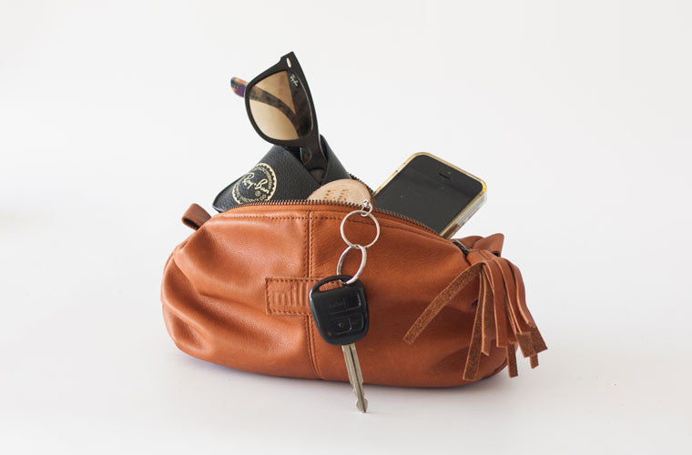 The Ariadne accessory bag in brown leather travel kit by milloo