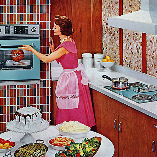 1959 suburban housewife standing in a kitchen cooking by an oven