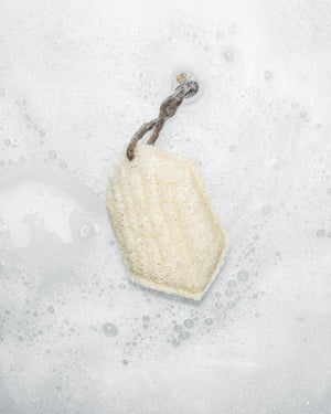 Sqwishful scrub sponge in foamy water