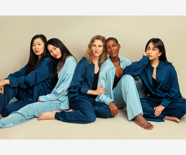 Sqwishful founder Jenn Tsang, Kim from Blue Brew Tea, Celine from Conspiracy Chocolate, Shawn, and Krystal from 852 Prints in pajamas made from up-cycled, salvaged fabrics by Róu So