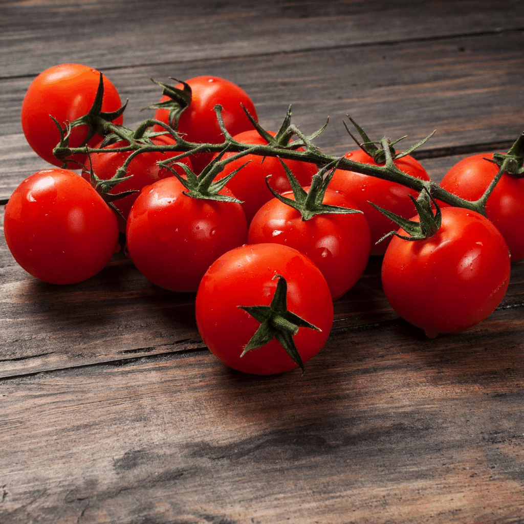 Cherry tomatoes placed on a table Buy cherry tomato seeds online