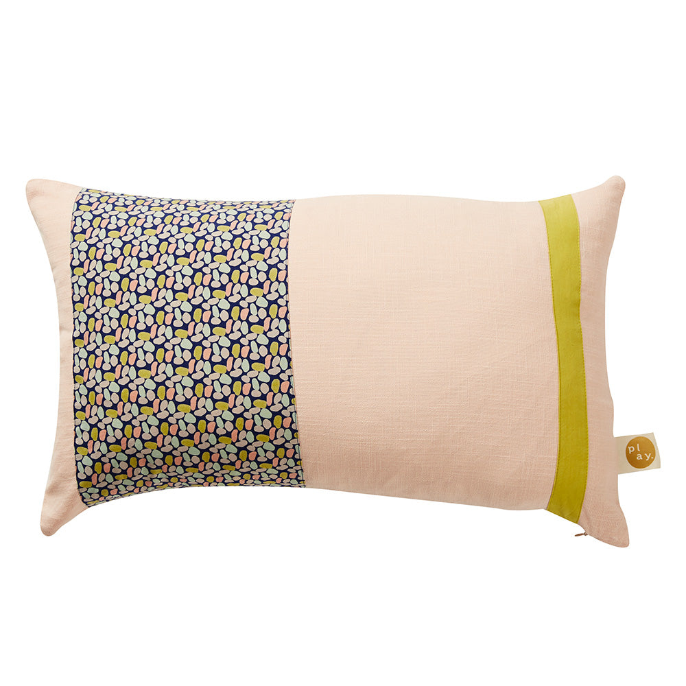 A vintage inspired patchwork cushion showcasing our handprinted brushstroke pattern and seasonal colours of blush and chartreuse