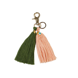 Tassel Key Ring in green pickle and cantaloupe peach pink. Hand crafted with evil eye and hand hamsa charms