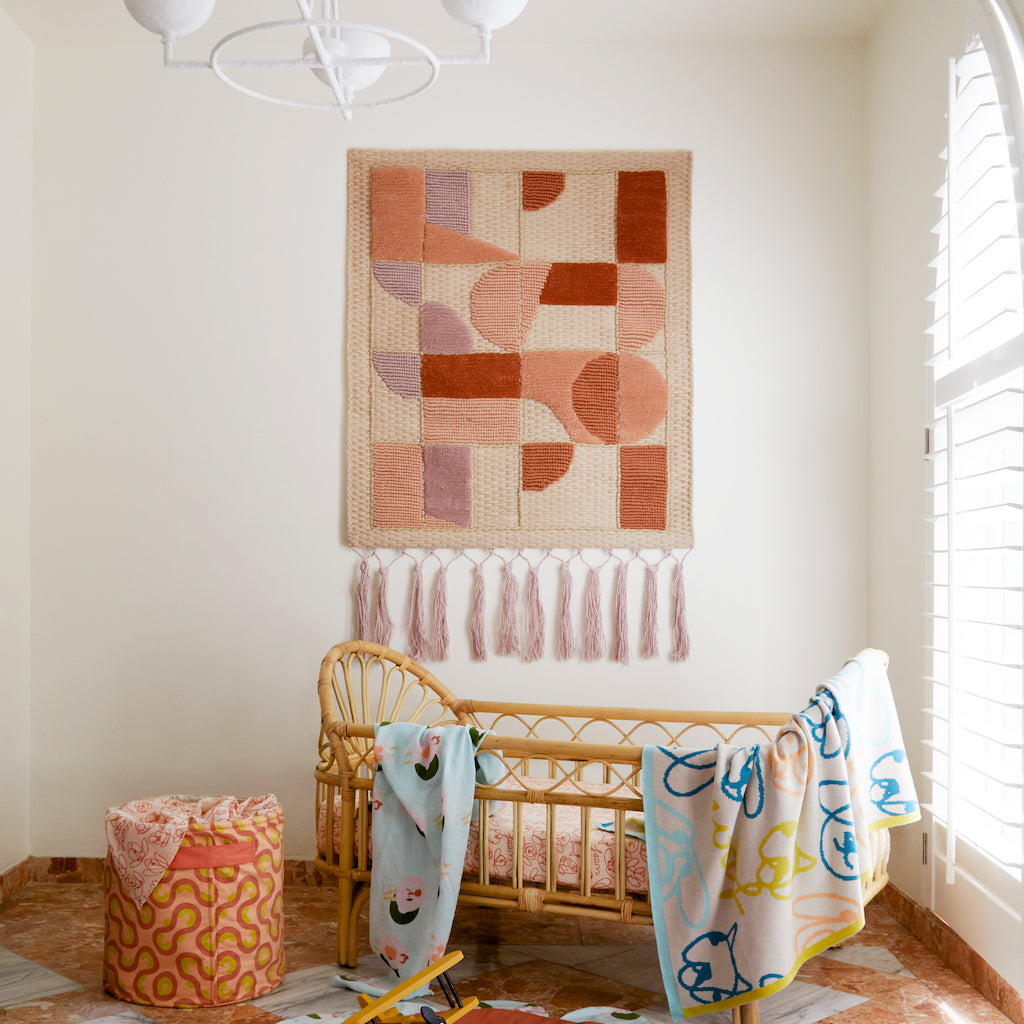 Alma woven geometric wool tufted wall hanging with fringing
