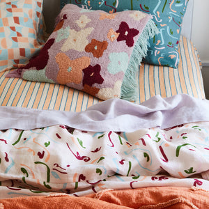 Blush quilt cover with colourful faces line drawing