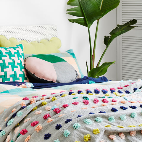 Bright and bold shades of emerald, blush and grey marle comprise this peace sign inspired round cushion design. Complete with contrast midnight blanket stitch edging and matching felt reverse.