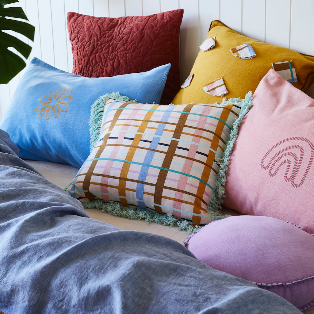 Colorado Semi Circle Cushion. Dandelion coloured cushion with semi circled cuts of fabric with a checked pattern.