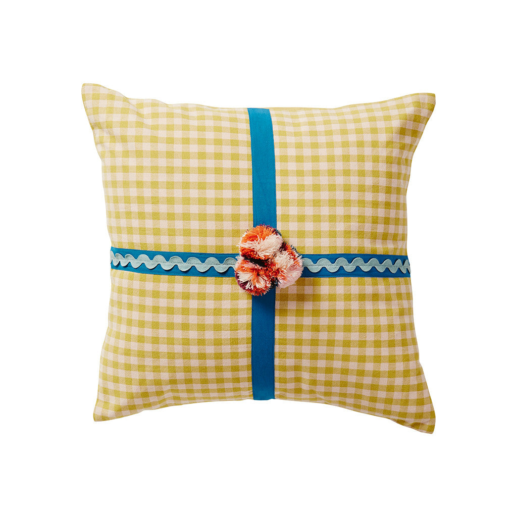 Contrast ric ric and ribbon define this gingham cotton cushion, embellished with hand crafted multicolour pom poms.