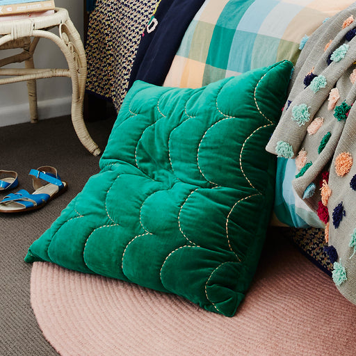 Embroidered coral scalloped stitching adorn this rich and luxurious emerald quilted sham.