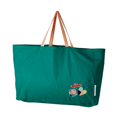 Emerald green canvas tote bag with a trio of hand embroidered badges inspired by this season's key prints and featuring contrast coral straps