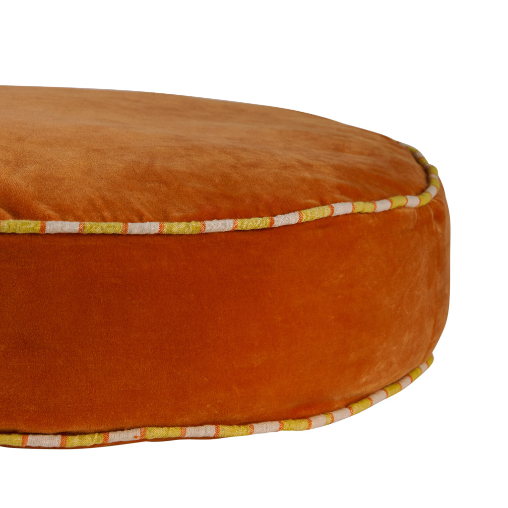 Etienne oversized round velvet floor cushion with piping clay
