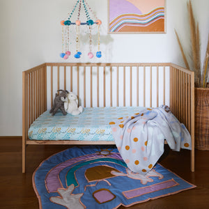 Fiesta play mat with appliqué patchwork motifs in shades of cornflower, terracotta, parchment, opal, taffy and dandelion on a lightly quilted cotton base.