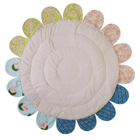 circle baby play mat with printed petals and quilting