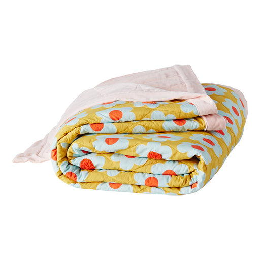 Generous quilted bedcover with hand printed sunflowers and boucle embroidery embellishments featuring blush velvet reverse and flange.