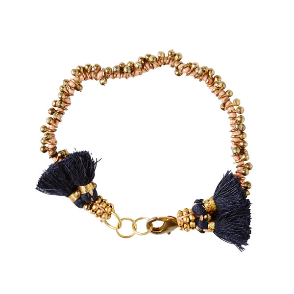 Gold and Cotton Bracelet with Tassle Embellishment
